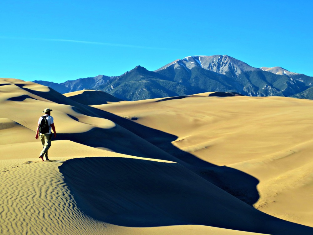 A trip to the Great Sand Dunes National Park in Southern Colorado is essentially a gigantic sand pit surrounded by 14,000 ft peaks. Photo by Wake and Wander.